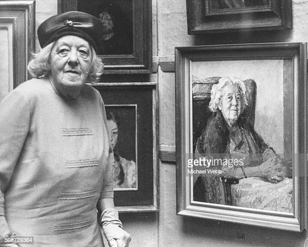 Actress Margaret Rutherford pictured viewing a portrait of herself painted by Michael Noakes RP at the Royal Society of Portrait Painters annual...