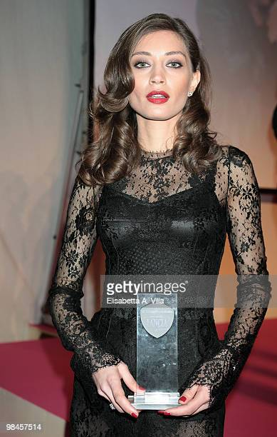 Actress Margareth Made shows her award during the '2010 Premio Afrodite' at the Studios on April 14 2010 in Rome Italy