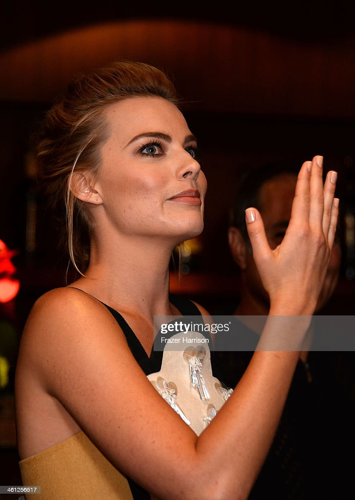 Actress <a gi-track='captionPersonalityLinkClicked' href=/galleries/search?phrase=Margot+Robbie&family=editorial&specificpeople=5781742 ng-click='$event.stopPropagation()'>Margot Robbie</a> attends an Australians In Film Screening Of 'The Wolf Of Wall Street' at Landmark Theatre on January 7, 2014 in Los Angeles, California.