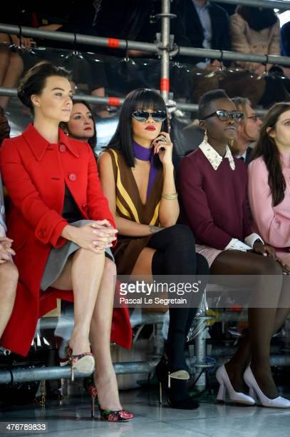 Actress Margot Robbie Rihanna and actress Lupita Nyong'o attend the Miu Miu show as part of the Paris Fashion Week Womenswear Fall/Winter 20142015 on...