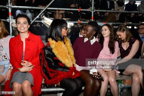 Actress Margot Robbie singer Rihanna actresses Lupita Nyong'o Elizabeth Olsen and Bella Heathcote attend the Miu Miu show as part of the Paris...