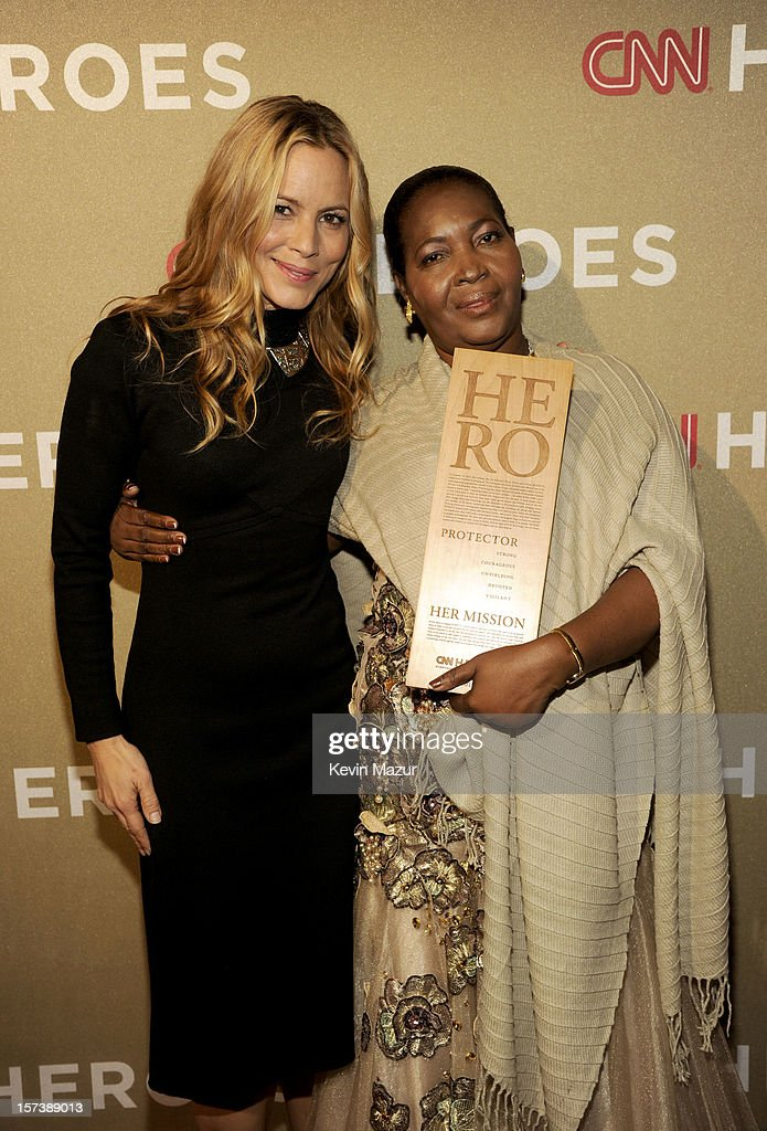 Actress <a gi-track='captionPersonalityLinkClicked' href=/galleries/search?phrase=Maria+Bello&family=editorial&specificpeople=201770 ng-click='$event.stopPropagation()'>Maria Bello</a> (L) and honoree Malya Villard-Appolon of KOFAVIV attend the CNN Heroes: An All Star Tribute at The Shrine Auditorium on December 2, 2012 in Los Angeles, California. 23046_005_KM_0273.JPG