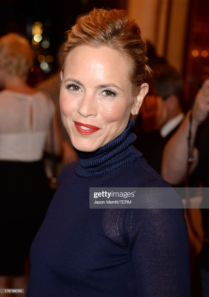 Actress <a gi-track='captionPersonalityLinkClicked' href=/galleries/search?phrase=Maria+Bello&family=editorial&specificpeople=201770 ng-click='$event.stopPropagation()'>Maria Bello</a> arrives at the 'Prisoners' premiere during the 2013 Toronto International Film Festival at The Elgin on September 6, 2013 in Toronto, Canada.