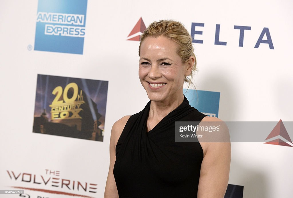 Actress <a gi-track='captionPersonalityLinkClicked' href=/galleries/search?phrase=Maria+Bello&family=editorial&specificpeople=201770 ng-click='$event.stopPropagation()'>Maria Bello</a> attends 'Hugh Jackman... One Night Only' Benefiting MPTF at Dolby Theatre on October 12, 2013 in Hollywood, California.
