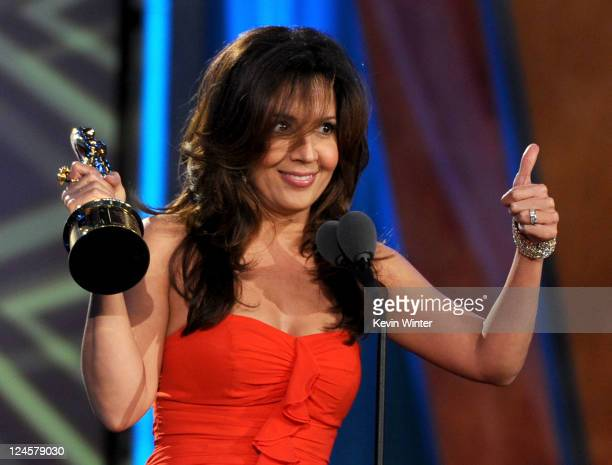 Actress Maria CanalsBarrera accepts the Favorite TV Actress Supporting Role award onstage during the 2011 NCLR ALMA Awards preshow held at Santa...