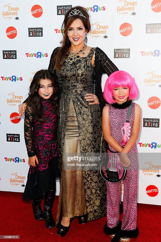 Actress Maria Canals-Barrera (C) and her daughters Bridget Barrera (L) and Madeleine Barrera attend the 2012 'Dream Halloween' presented by Keep A Child Alive at Barker Hangar on October 27, 2012 in Santa Monica, California.