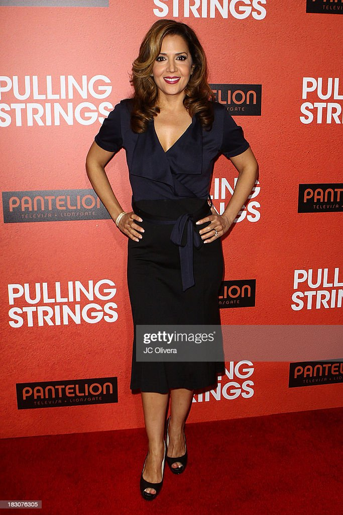 Actress <a gi-track='captionPersonalityLinkClicked' href=/galleries/search?phrase=Maria+Canals-Barrera&family=editorial&specificpeople=5397881 ng-click='$event.stopPropagation()'>Maria Canals-Barrera</a> attends Los Angeles Premiere of 'Pulling Strings' at Regal Cinemas L.A. Live on October 3, 2013 in Los Angeles, California.