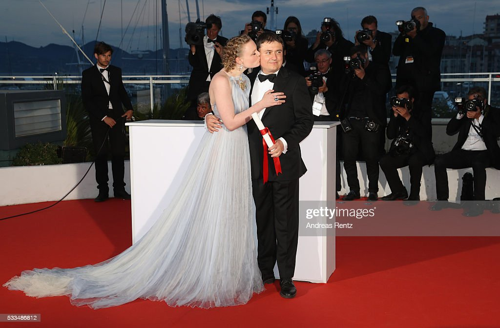 Actress Maria Dragus kisses Romanian director <a gi-track='captionPersonalityLinkClicked' href=/galleries/search?phrase=Cristian+Mungiu&family=editorial&specificpeople=4292523 ng-click='$event.stopPropagation()'>Cristian Mungiu</a> for winning the Best Director prize for the film 'Graduation (Bacalaureat)' at the Palme D'Or Winner Photocall during the 69th annual Cannes Film Festival at the Palais des Festivals on May 22, 2016 in Cannes, France.