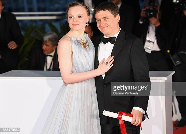 Actress Maria Dragus poses with Romanian director Cristian Mungiu winner of the Best Director prize for the film 'Graduation ' at the Palme D'Or...
