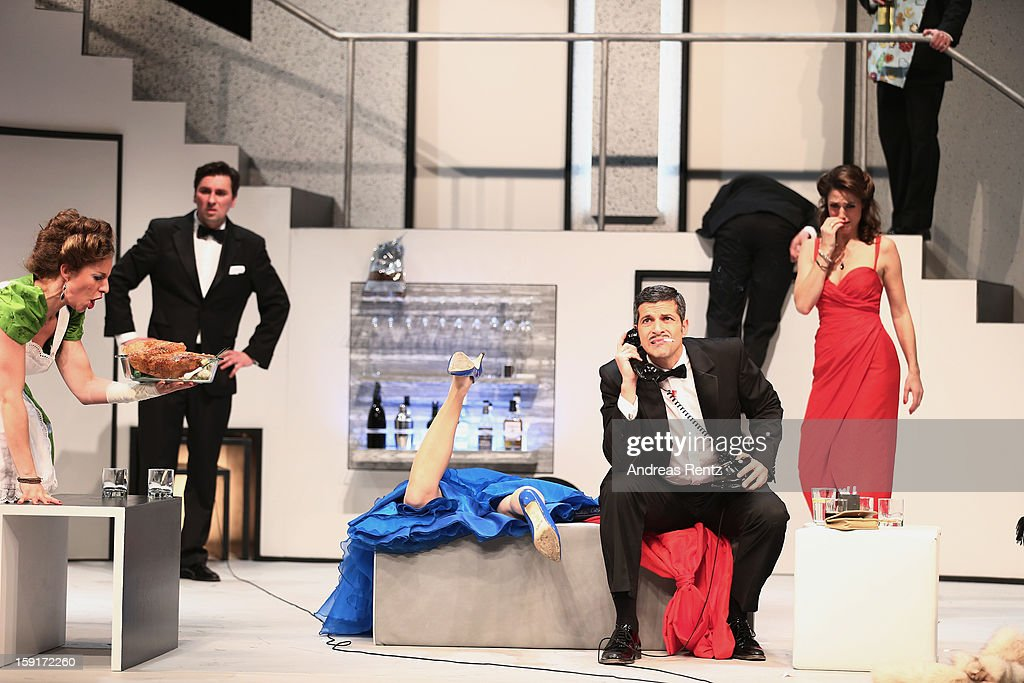Actress Maria Furtwaengler and actor Pasquale Aleardi perform during the 'Geruechte...Geruechte...' photo rehearsal at Komoedie am Kurfuerstendamm Theater on January 9, 2013 in Berlin, Germany.
