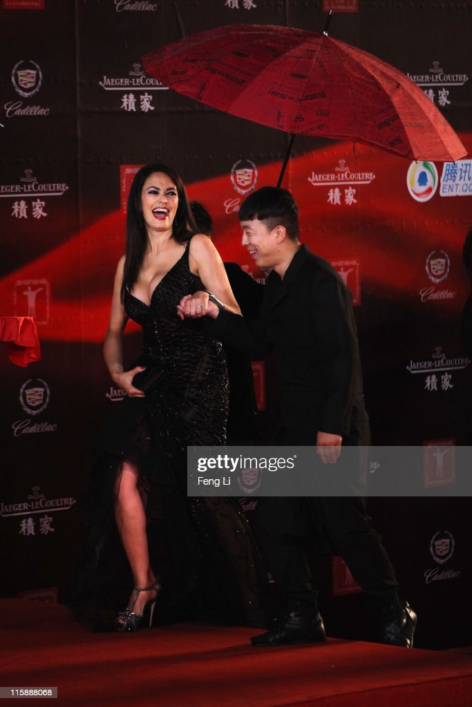 Actress <a gi-track='captionPersonalityLinkClicked' href=/galleries/search?phrase=Maria+Grazia+Cucinotta&family=editorial&specificpeople=236018 ng-click='$event.stopPropagation()'>Maria Grazia Cucinotta</a> (L) and actor Huang Bo (R) arrive at the opening ceremony of the 14th Shanghai International Film Festival on June 11, 2011 in Shanghai, China.