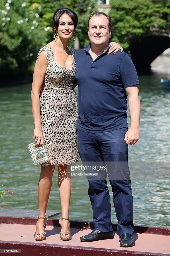 Actress Maria Grazia Cucinotta and Giulio Violati are seen during the 70th Venice International Film Festival on September 4, 2013 in Venice, Italy.