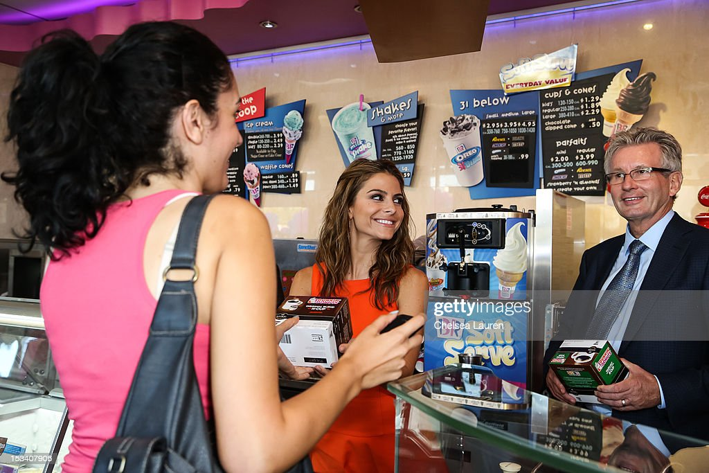 Actress <a gi-track='captionPersonalityLinkClicked' href=/galleries/search?phrase=Maria+Menounos&family=editorial&specificpeople=203337 ng-click='$event.stopPropagation()'>Maria Menounos</a> (C) and CEO of Dunkin' brands / president of Dunkin' Donuts Nigel Travis (R) attend the launch of Dunkin' Donuts K-Cups at Baskin-Robbins on October 4, 2012 in Burbank, California.