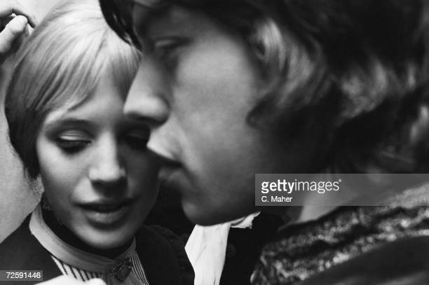 Actress Marianne Faithfull backstage with her boyfriend Mick Jagger after her first night performance as Irina in Chekov's 'The Three Sisters' at the...