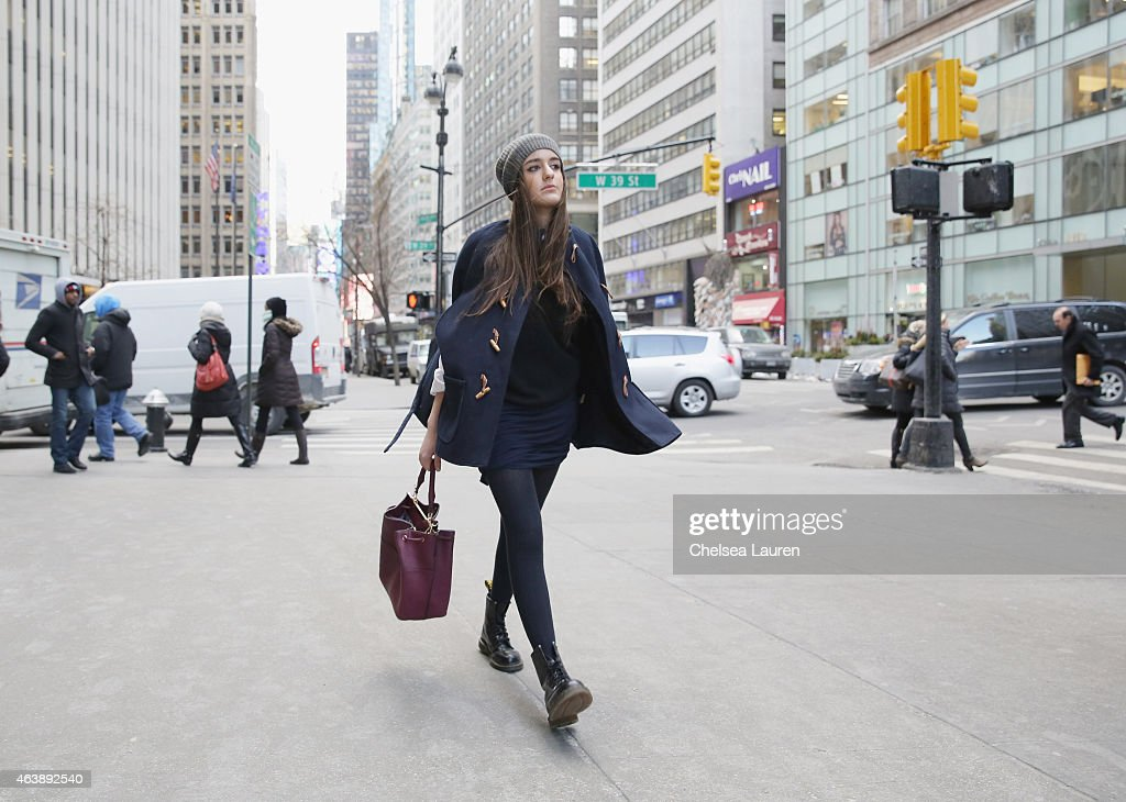 Actress Marie Calfat Nascimento wearing a Charlotte Ronson Fall 2015 navy ribbed washable skirt with her own Lord Taylor black cashmere sweater Zara...