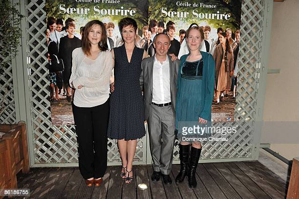 Actress Marie Kremer Cecile De France Director Stijn Coninx and actress Christelle Cornil attend the premiere of ''Soeur Sourire'' at the Cinema...