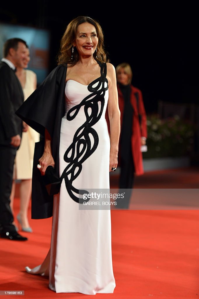 Actress Marie Rosaria Omaggio arrives for the screening of 'Walesa - Man of Hope' presented out of competition at the 70th Venice Film Festival on September 5, 2013 at Venice Lido. AFP PHOTO / GABRIEL BOUYS