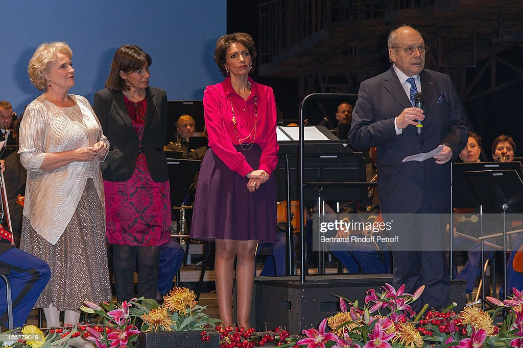 Actress Marie-Christine Barrault, President of the Gala de l'Espoir charity event against cancer, Paris Deputy Mayor Anne Hidalgo and Marisol Touraine, Minister of Social Affairs and Health, listen to Guy Berger, President of the Paris Committee of the French League Against Cancer, as he delivers a speech on stage during the Gala de l'Espoir event at Theatre du Chatelet on November 12, 2012 in Paris, France.