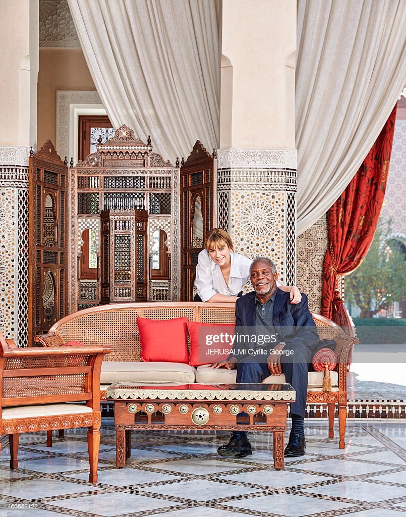 Actress MarieJosee Croze and Danny Glover pose in the lounge of the Hotel Royal Mansour during the 14th Film Festival of Marrakech on December 8 2014