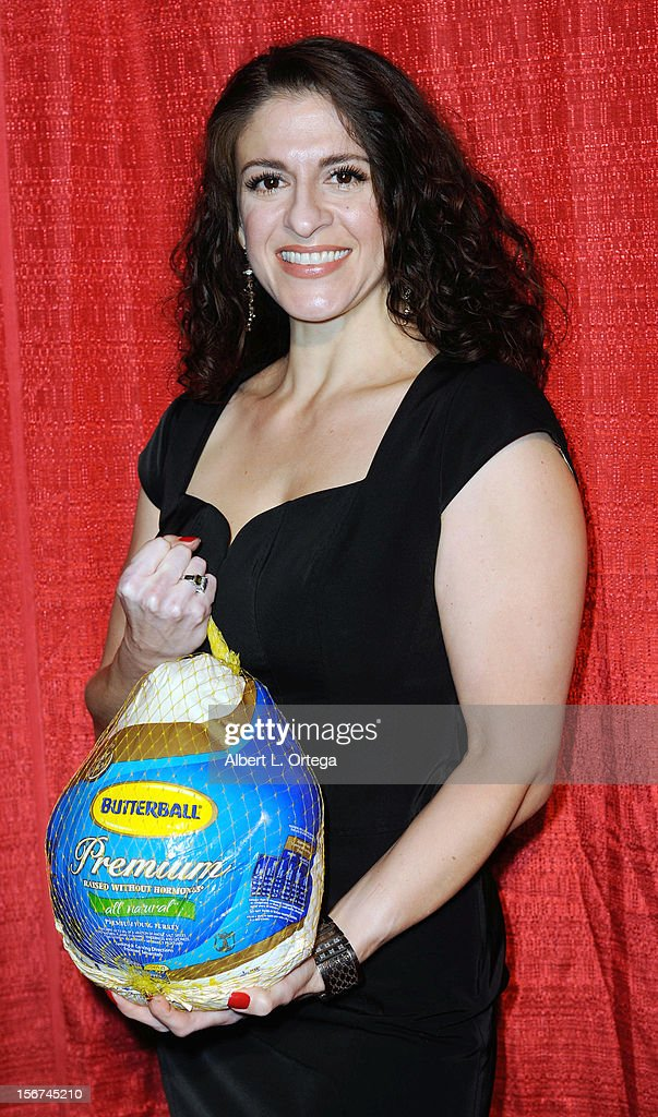 Actress Marietta Putignano arrives for Jackson Limousine Homeless Turkey Drive Red Carpet Gala held at Infusion Lounge on November 19, 2012 in Universal City, California.