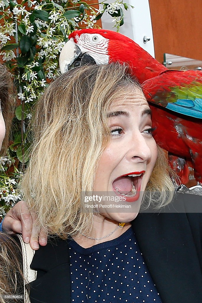 Actress <a gi-track='captionPersonalityLinkClicked' href=/galleries/search?phrase=Marilou+Berry&family=editorial&specificpeople=672535 ng-click='$event.stopPropagation()'>Marilou Berry</a> poses with parrot Arthur during Day Height of the 2016 French Tennis Open at Roland Garros on May 29, 2016 in Paris, France.
