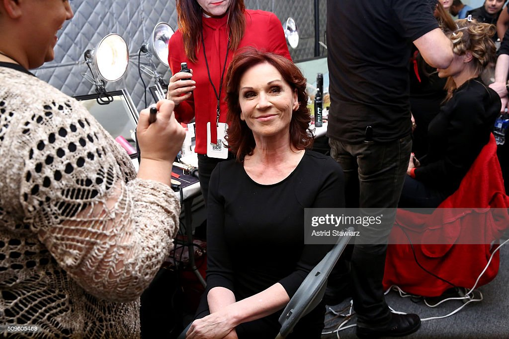 Actress <a gi-track='captionPersonalityLinkClicked' href=/galleries/search?phrase=Marilu+Henner&family=editorial&specificpeople=213140 ng-click='$event.stopPropagation()'>Marilu Henner</a> prepares backstage at The American Heart Association's Go Red For Women Red Dress Collection 2016 Presented By Macy's at The Arc, Skylight at Moynihan Station on February 11, 2016 in New York City.