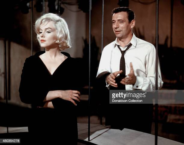 Actress Marilyn Monroe and Yves Montand in a scene from her 1960 film 'Let's Make Love' in Los Angeles California