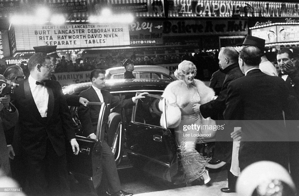 Actress <a gi-track='captionPersonalityLinkClicked' href=/galleries/search?phrase=Marilyn+Monroe&family=editorial&specificpeople=70021 ng-click='$event.stopPropagation()'>Marilyn Monroe</a> (C) emerging from limo upon arrival at premiere of her new film Some Like It Hot in Times Square.
