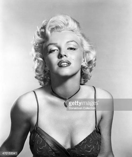Actress Marilyn Monroe poses for a publicity portrait for the 20th CenturyFox movie 'River of No Return' in 1954 in Los Angeles California