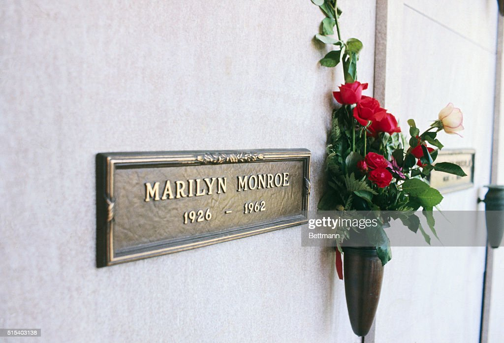Actress Marilyn Monroe's crypt in Westwood Memorial Park with a spray of red roses