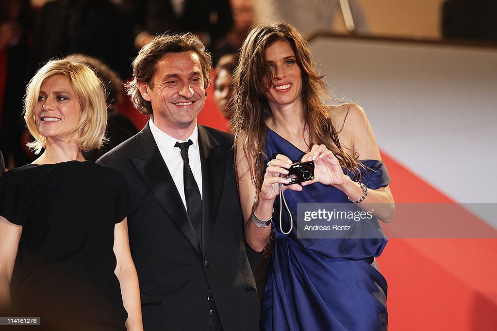 Actress <a gi-track='captionPersonalityLinkClicked' href=/galleries/search?phrase=Marina+Fois&family=editorial&specificpeople=760498 ng-click='$event.stopPropagation()'>Marina Fois</a> with actor Louis Do De Lencquesaing and director <a gi-track='captionPersonalityLinkClicked' href=/galleries/search?phrase=Maiwenn+Le+Besco&family=editorial&specificpeople=3961805 ng-click='$event.stopPropagation()'>Maiwenn Le Besco</a> attend the 'Polisse' premiere at the Palais des Festivals during the 64th Cannes Film Festival on May 13, 2011 in Cannes, France.