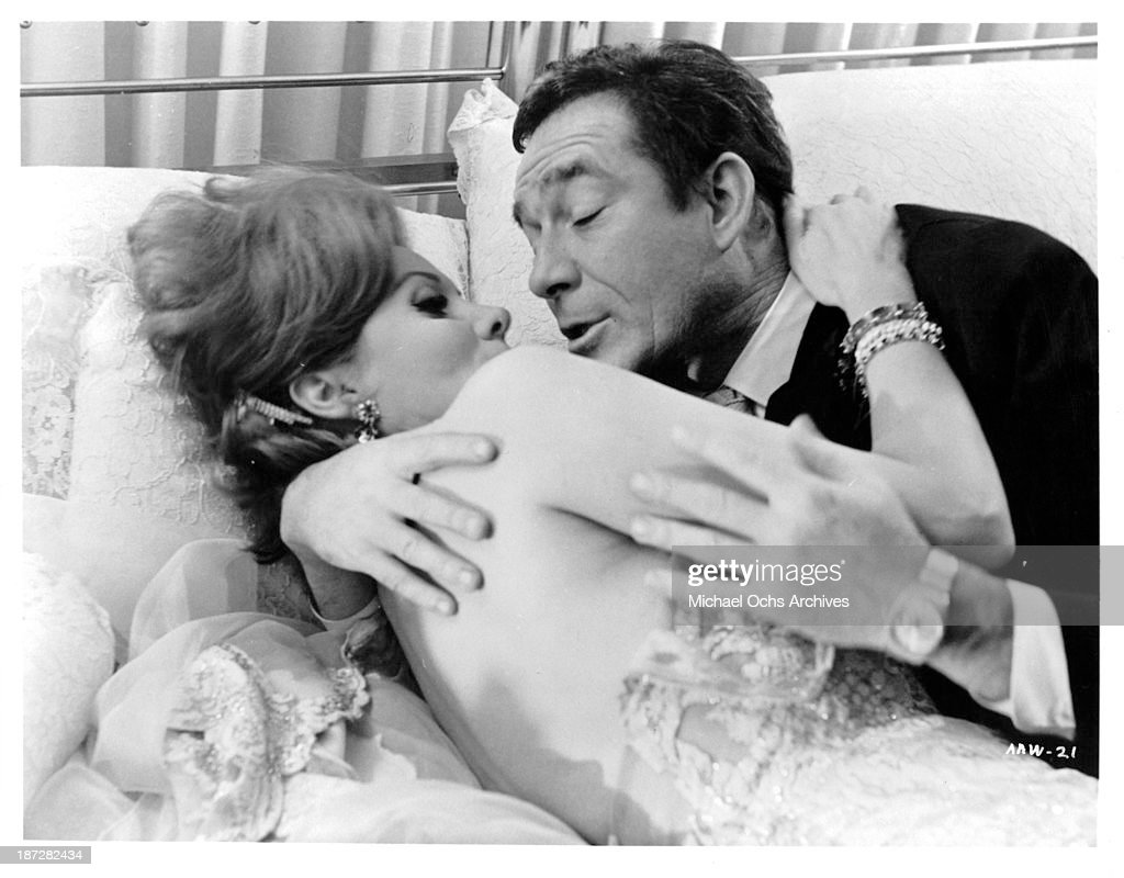 Actress Marina Vlady and actor Ugo Tognazzi on set of the movie 'Run for Your Wife' in 1965