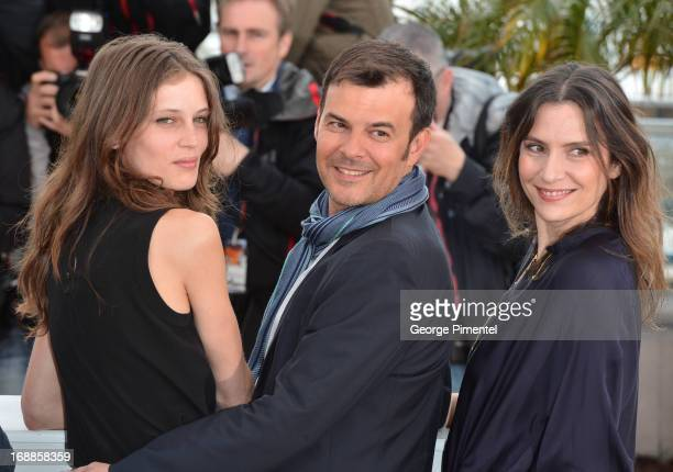 Actress Marine Vacth director Francois Ozon and actress Geraldine Pailhas attends the photocall for 'Jeune Jolie' at The 66th Annual Cannes Film...
