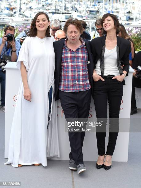 Actress Marion Cotillard actor Mathieu Amalric and actress Charlotte Gainsbourg attend the 'Ismael's Ghosts ' photocall during the 70th annual Cannes...