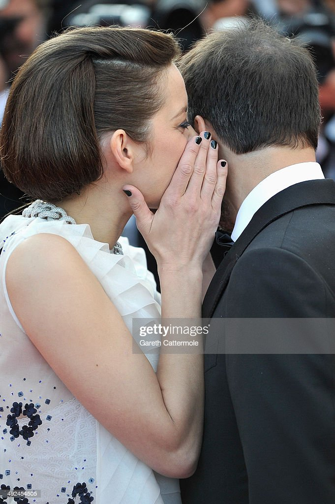 Actress <a gi-track='captionPersonalityLinkClicked' href=/galleries/search?phrase=Marion+Cotillard&family=editorial&specificpeople=215303 ng-click='$event.stopPropagation()'>Marion Cotillard</a> and actor <a gi-track='captionPersonalityLinkClicked' href=/galleries/search?phrase=Fabrizio+Rongione&family=editorial&specificpeople=5349599 ng-click='$event.stopPropagation()'>Fabrizio Rongione</a> attend the 'Two Days, One Night' (Deux Jours, Une Nuit) premiere during the 67th Annual Cannes Film Festival on May 20, 2014 in Cannes, France.