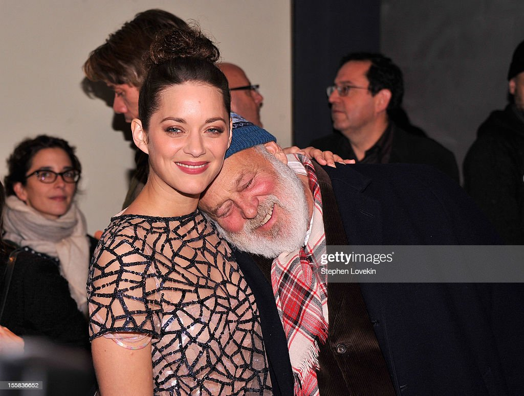 Actress <a gi-track='captionPersonalityLinkClicked' href=/galleries/search?phrase=Marion+Cotillard&family=editorial&specificpeople=215303 ng-click='$event.stopPropagation()'>Marion Cotillard</a> and Bruce Weber attend The Cinema Society with Dior & Vanity Fair screening of 'Rust And Bone' at Landmark Sunshine Cinema on November 8, 2012 in New York City.