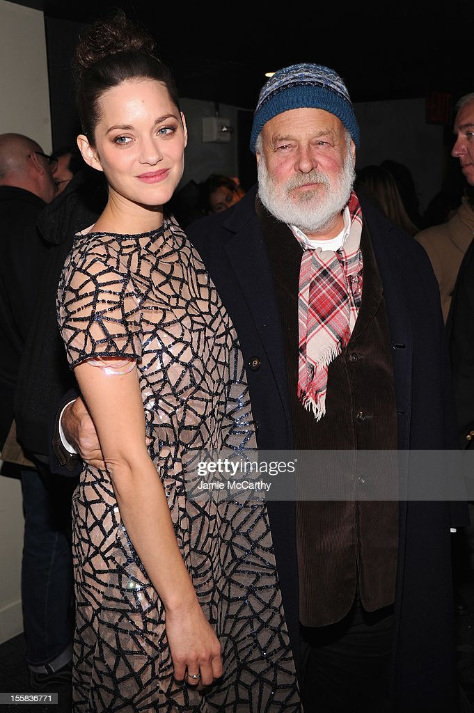 Actress <a gi-track='captionPersonalityLinkClicked' href=/galleries/search?phrase=Marion+Cotillard&family=editorial&specificpeople=215303 ng-click='$event.stopPropagation()'>Marion Cotillard</a> and <a gi-track='captionPersonalityLinkClicked' href=/galleries/search?phrase=Bruce+Weber&family=editorial&specificpeople=206240 ng-click='$event.stopPropagation()'>Bruce Weber</a> attend The Cinema Society with Dior & Vanity Fair screening of 'Rust And Bone' at Landmark Sunshine Cinema on November 8, 2012 in New York City.