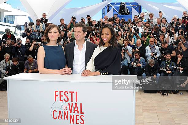 Actress Marion Cotillard and director and actor Guillaume Canet and actress Zoe Saldana attend the photocall for 'Blood Ties' at The 66th Annual...