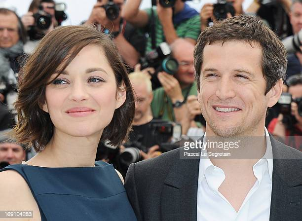 Actress Marion Cotillard and director and actor Guillaume Canet attends the photocall for 'Blood Ties' at The 66th Annual Cannes Film Festival on May...