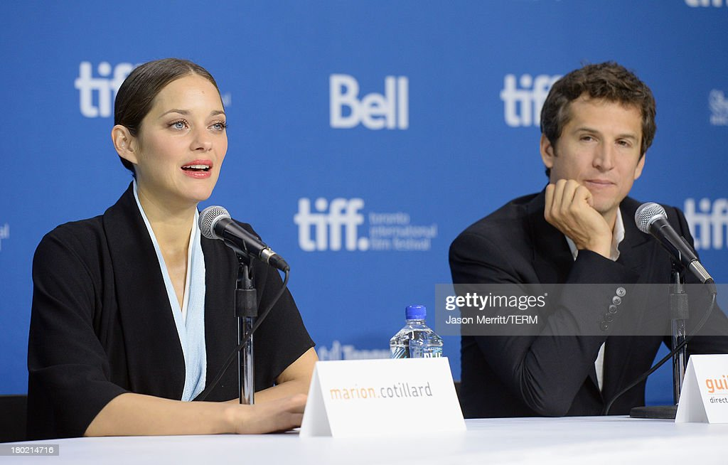 Actress <a gi-track='captionPersonalityLinkClicked' href=/galleries/search?phrase=Marion+Cotillard&family=editorial&specificpeople=215303 ng-click='$event.stopPropagation()'>Marion Cotillard</a> and director <a gi-track='captionPersonalityLinkClicked' href=/galleries/search?phrase=Guillaume+Canet&family=editorial&specificpeople=240267 ng-click='$event.stopPropagation()'>Guillaume Canet</a> speak onstage at 'Blood Ties' Press Conference during the 2013 Toronto International Film Festival at TIFF Bell Lightbox on September 10, 2013 in Toronto, Canada.