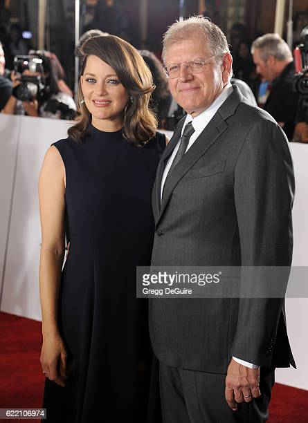 Actress Marion Cotillard and director Robert Zemeckis arrive at the fan event for Paramount Pictures' 'Allied' at Regency Village Theatre on November...