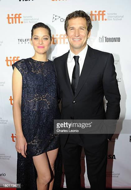 Actress Marion Cotillard and director/ writer Guillaume Canet arrive at the 'Blood Ties' Premiere during the 2013 Toronto International Film Festival...
