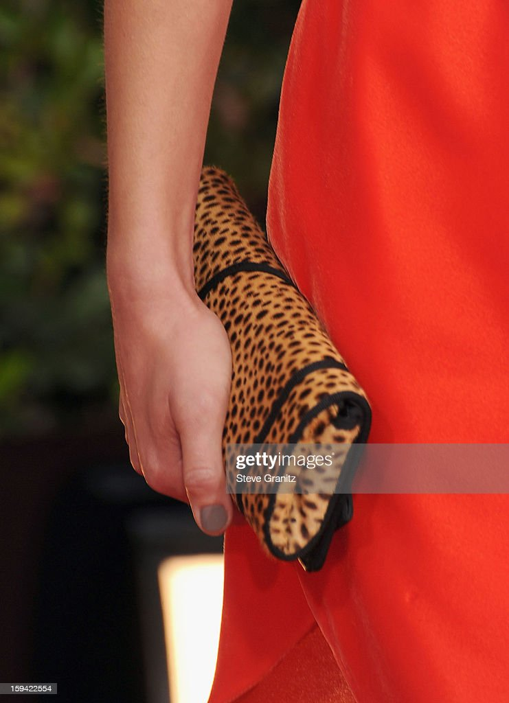 Actress Marion Cotillard (purse detail) arrives at the 70th Annual Golden Globe Awards held at The Beverly Hilton Hotel on January 13, 2013 in Beverly Hills, California.