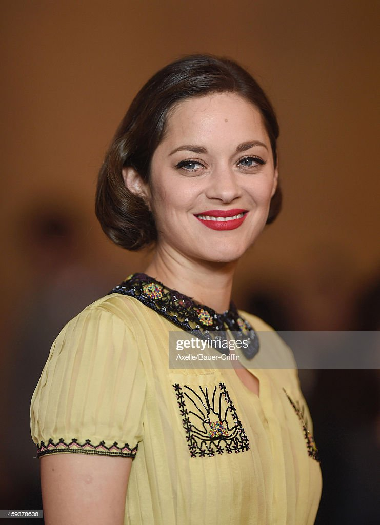 Actress <a gi-track='captionPersonalityLinkClicked' href=/galleries/search?phrase=Marion+Cotillard&family=editorial&specificpeople=215303 ng-click='$event.stopPropagation()'>Marion Cotillard</a> arrives at the AFI FEST 2014 Presented By Audi - 'Two Days, One Night' special screening at the Egyptian Theatre on November 7, 2014 in Holywood, California.