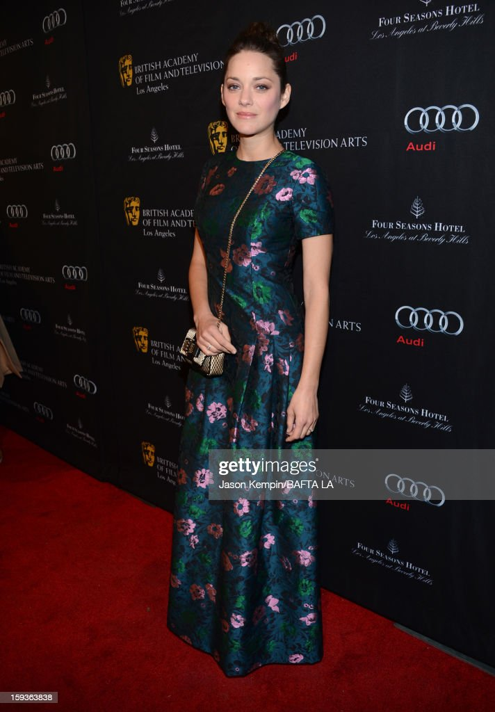 Actress <a gi-track='captionPersonalityLinkClicked' href=/galleries/search?phrase=Marion+Cotillard&family=editorial&specificpeople=215303 ng-click='$event.stopPropagation()'>Marion Cotillard</a> arrives at the BAFTA Los Angeles 2013 Awards Season Tea Party held at the Four Seasons Hotel Los Angeles on January 12, 2013 in Los Angeles, California.