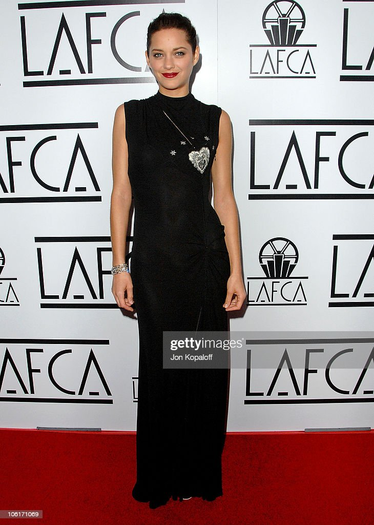 Actress <a gi-track='captionPersonalityLinkClicked' href=/galleries/search?phrase=Marion+Cotillard&family=editorial&specificpeople=215303 ng-click='$event.stopPropagation()'>Marion Cotillard</a> arrives to The 33rd Annual Los Angeles Film Critics Awards at the InterContinental Hotel on January 12, 2008 in Century City, California