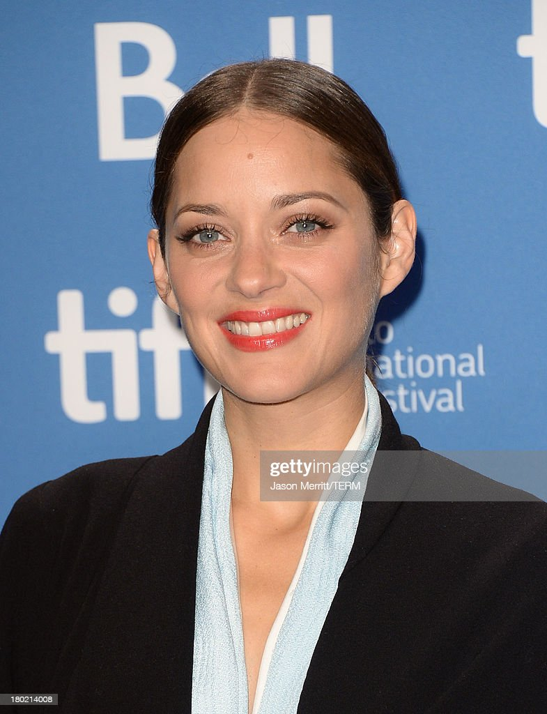 Actress <a gi-track='captionPersonalityLinkClicked' href=/galleries/search?phrase=Marion+Cotillard&family=editorial&specificpeople=215303 ng-click='$event.stopPropagation()'>Marion Cotillard</a> attends 'Blood Ties' Press Conference during the 2013 Toronto International Film Festival at TIFF Bell Lightbox on September 10, 2013 in Toronto, Canada.
