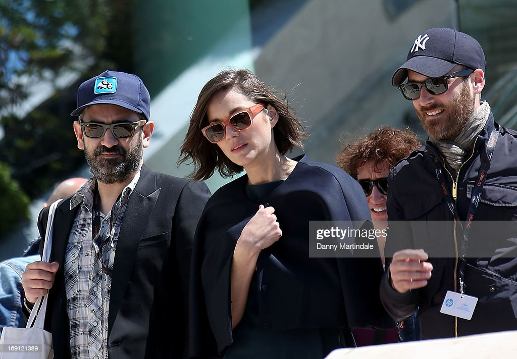 Actress <a gi-track='captionPersonalityLinkClicked' href=/galleries/search?phrase=Marion+Cotillard&family=editorial&specificpeople=215303 ng-click='$event.stopPropagation()'>Marion Cotillard</a> (C) attends day 6 of the 66th Annual Cannes Film Festival>> on May 20, 2013 in Cannes, France.