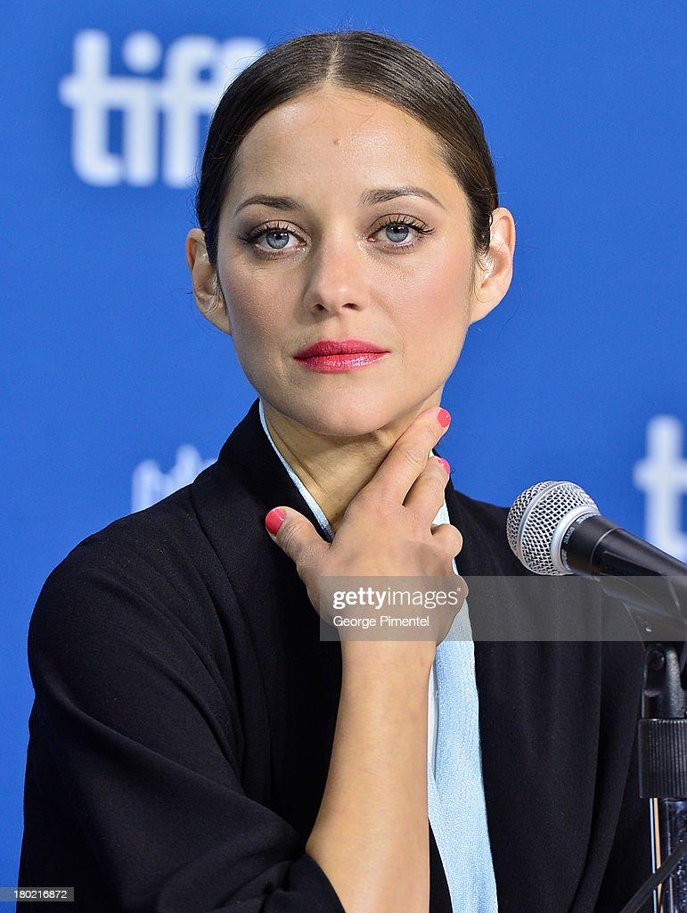 Actress <a gi-track='captionPersonalityLinkClicked' href=/galleries/search?phrase=Marion+Cotillard&family=editorial&specificpeople=215303 ng-click='$event.stopPropagation()'>Marion Cotillard</a> attends the 'Blood Ties' Press Conference during the 2013 Toronto International Film Festival at TIFF Bell Lightbox on September 10, 2013 in Toronto, Canada.