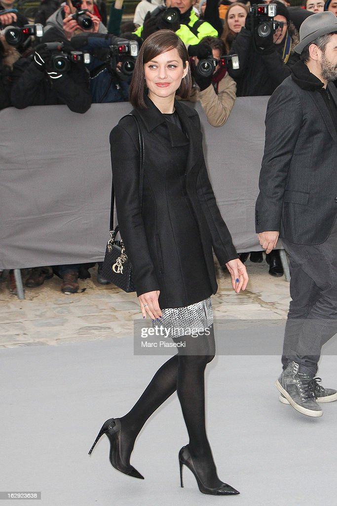 Actress Marion Cotillard attends the 'Christian Dior' Fall/Winter 2013 Ready-to-Wear show as part of Paris Fashion Week on March 1, 2013 in Paris, France.